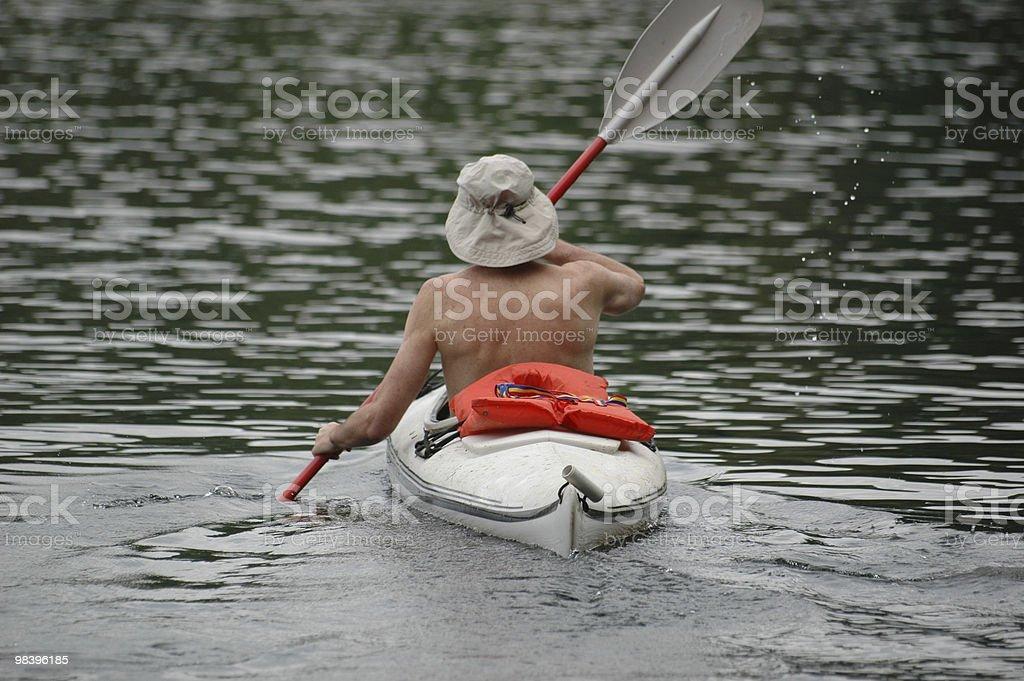 Flatwater kayaking on a lake. stock photo