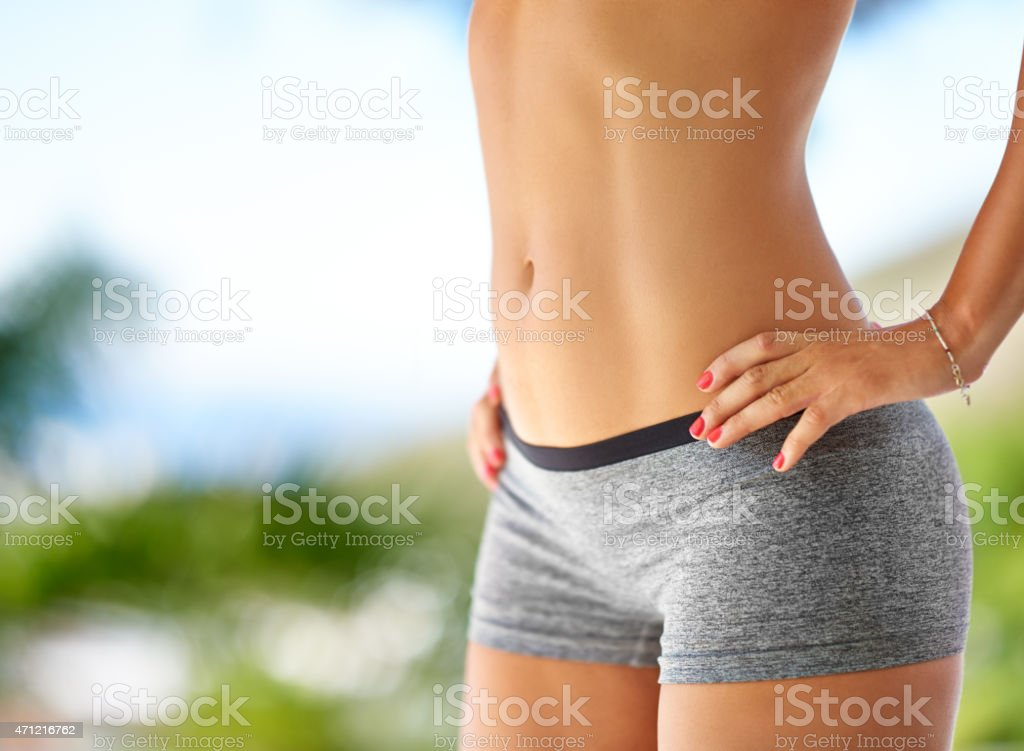 Flaunting her fab abs stock photo