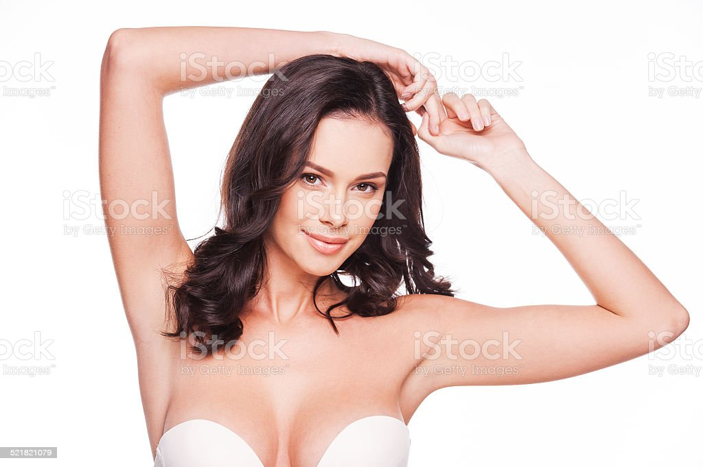 Flaunting her femininity. stock photo