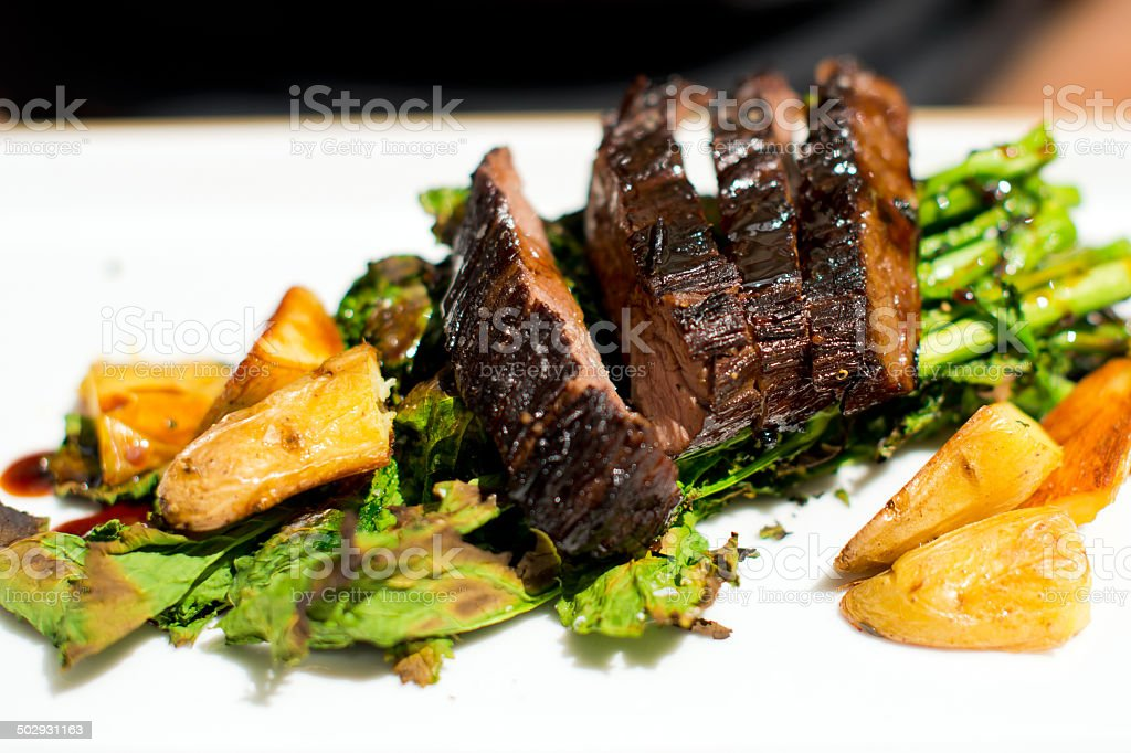 Flavored beef steak cobby with herbs and potatoes stock photo