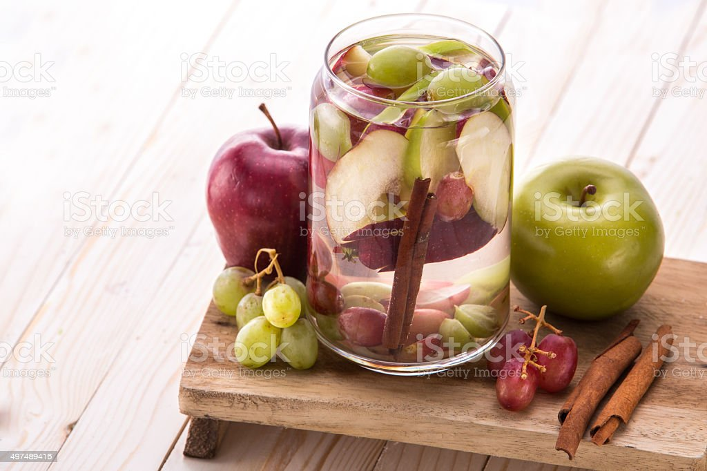 Flavored infused water mix of Apple, grape and cinnamon stock photo