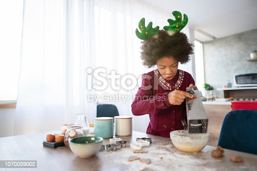 Portrait of a girl making Christmas cookies.