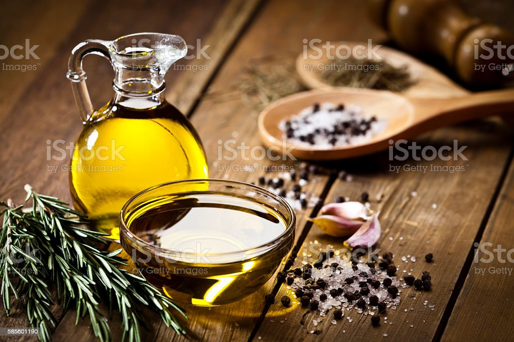 Flavoring: olive oil, garlic, pepper, salt and rosemary stock photo