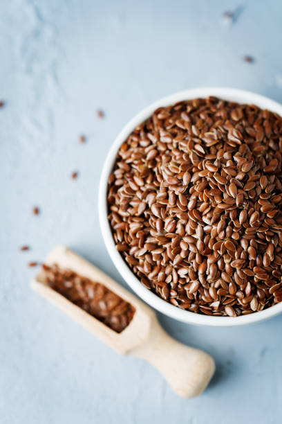 flax seed in white bowl stock photo
