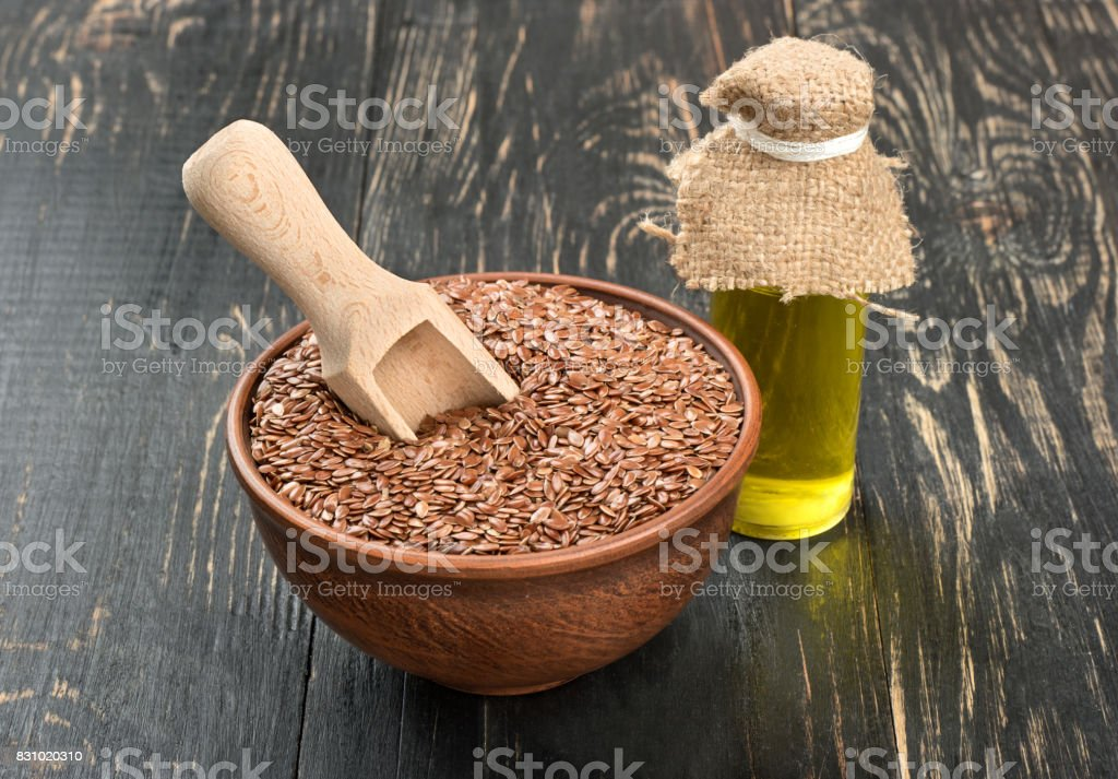 Flax seeds in bowl stock photo