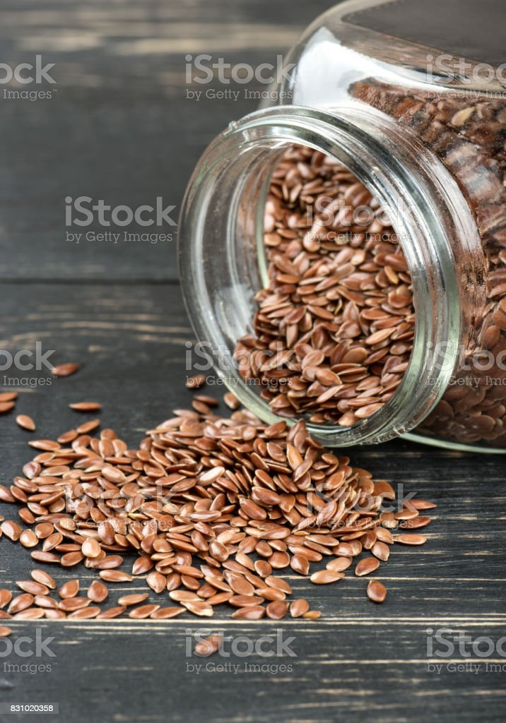 Flax seeds in jar stock photo