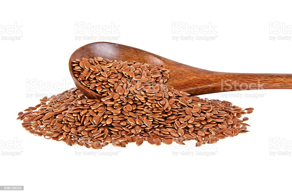 Flax seeds in wooden spoon isolated on white background stock photo