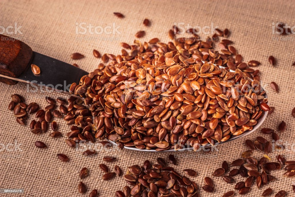 Flax seeds linseed on kitchen spoon royalty-free stock photo