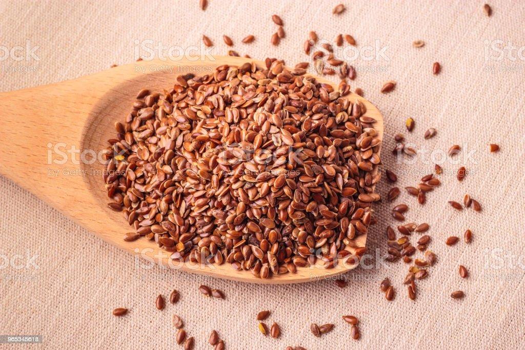 Flax seeds linseed on wooden spoon zbiór zdjęć royalty-free