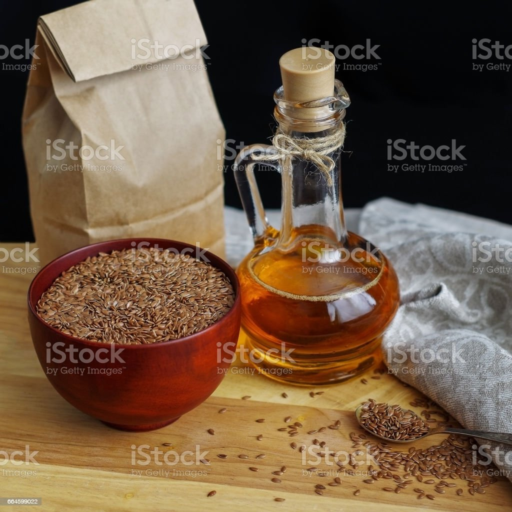 Flax Seeds On Spoon And In Wooden Bowl Linseed Oil In Glass Jug On