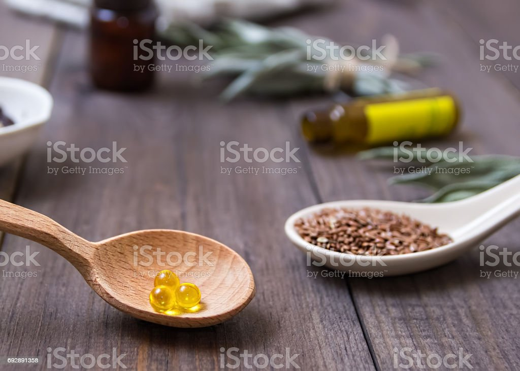 Flaxseed Oil In Caps On A Wooden Background Phytotherapy Linum