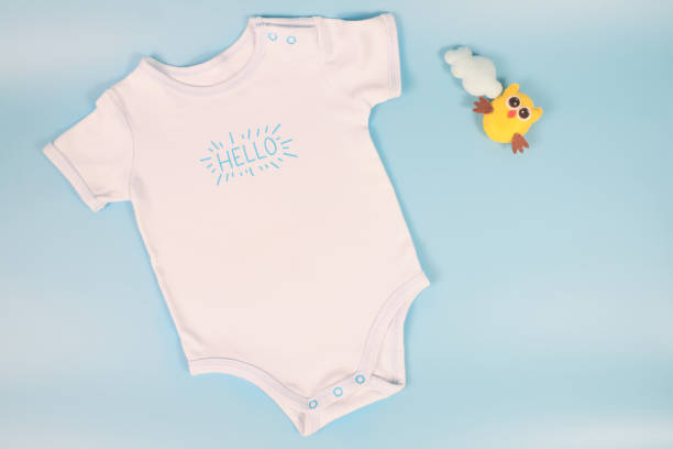 Flay lay of blue baby bodysuit for baby boy isolated on blue colored picture id1199587763?b=1&k=6&m=1199587763&s=612x612&w=0&h=dndk5zgoga2xxhnlcnkmkq6fvhmexgokjyjmlpja9hy=