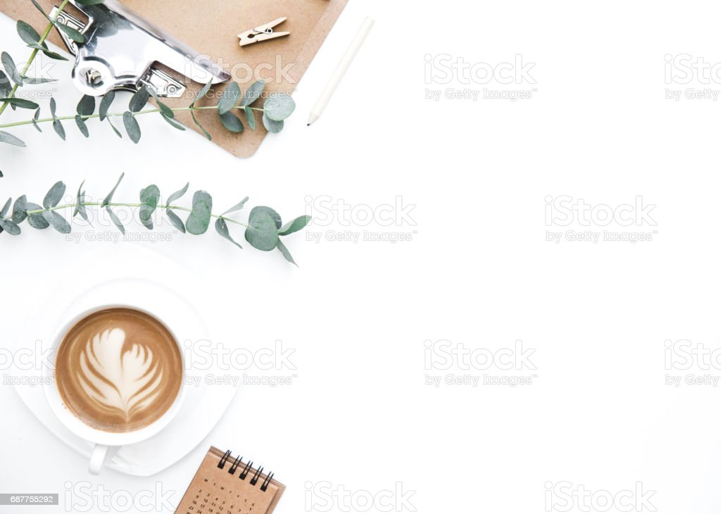 Flay lay, Top view office table desk. Feminine desk workspace frame with clipboard and coffee  on white background.  ideas, notes or plan writing concept stock photo