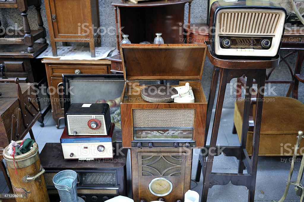 Flea market and radio equipment. Flea market stall with obsolete radio equipment and record player. Antique Shop Stock Photo