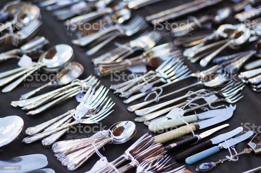 Flea Market cutlery for sale stock photo