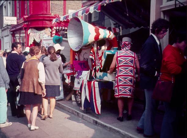 Flea market on Carnaby St., London London, England, UK, 1969. Flea market on Carnaby Street in London. Tourists and Londoners stroll in downtown by the Carnaby St. and inspect the goods in shops and sales stands. carnaby street stock pictures, royalty-free photos & images