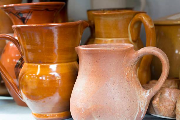 Flea market terracotta jugs stock photo