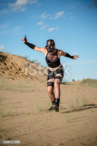 Wearing a gasmask and fleeing the sceen in this chaotic apocalypse