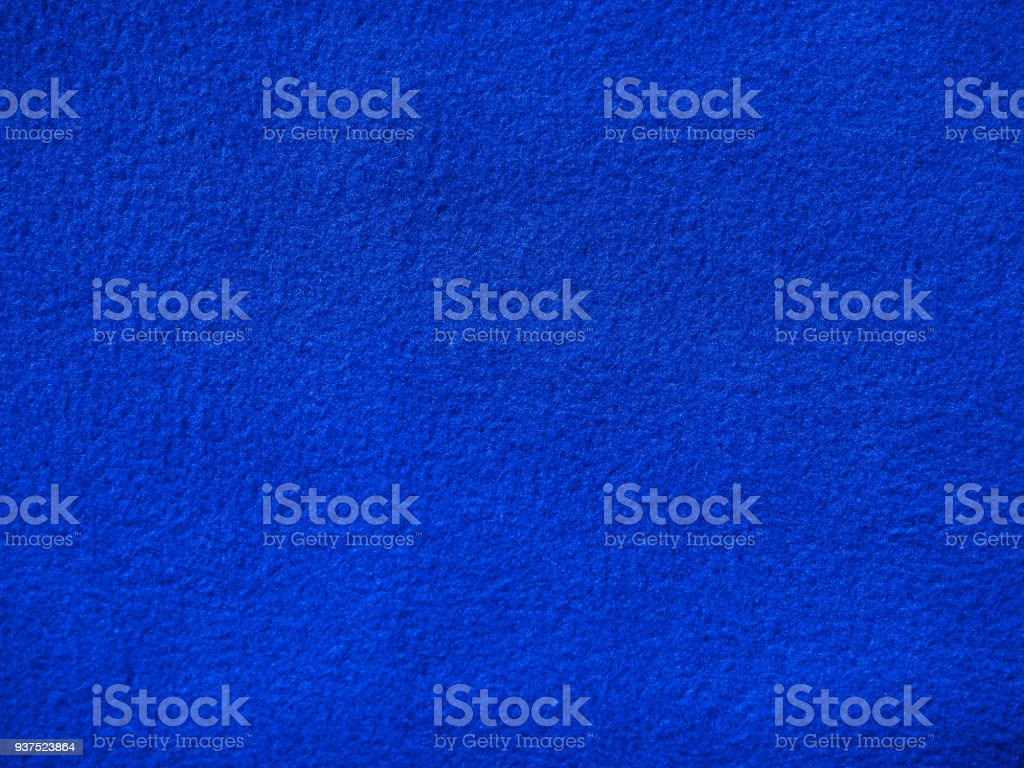 Fleece background, color royal blue. Terry cloth. Blanket of furry fleece fabric. Texture of light blue soft plush material stock photo