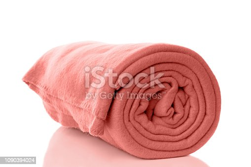 rolled up fleece blanket in living coral - color of the year 2019