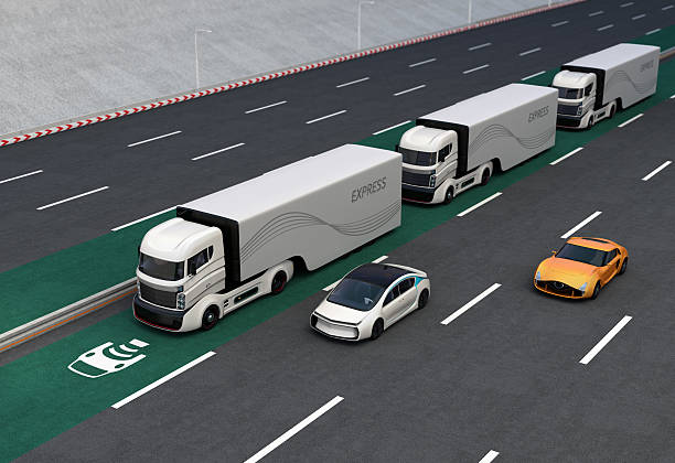 fleet of autonomous hybrid trucks driving on wireless charging lane - independence stock photos and pictures