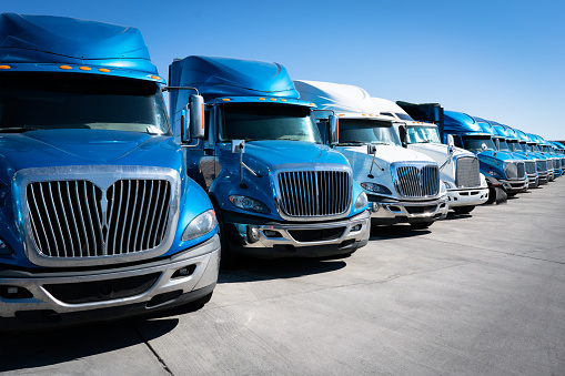 Fleet Of Blue 18 Wheeler Semi Trucks Stock Photo - Download Image Now