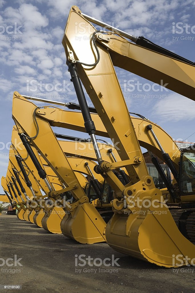 Fleet of excavators sitting in a lot royalty-free stock photo