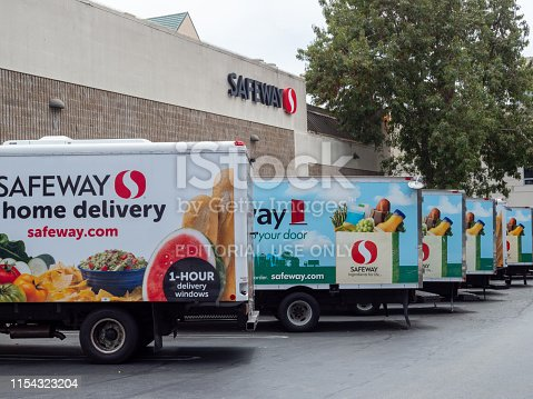 San Francisco, CA JULY 29, 2018: Fleet of Safeway home grocery delivery trucks outside of store location