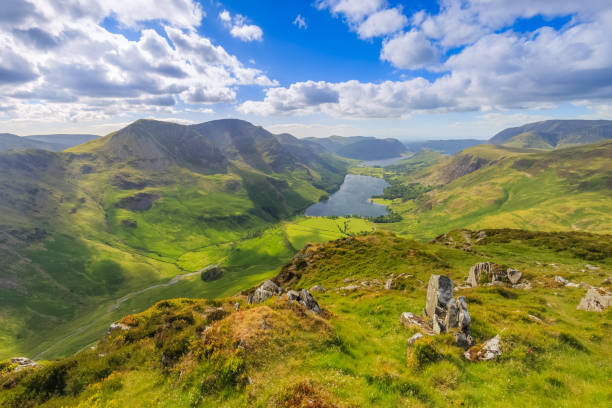Fleetwith Pike summit overlooking Buttermere Fleetwith Pike summit overlooking Buttermere, Cumbria, England cumbria stock pictures, royalty-free photos & images