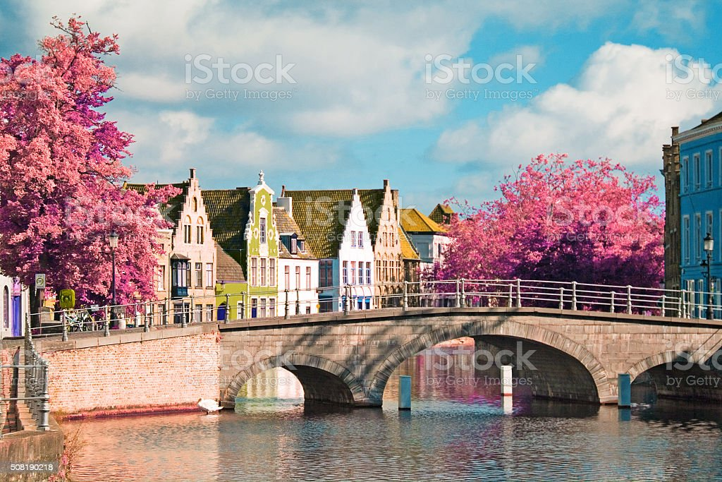 flemish houses and bridge over canal in Brugge, Belgium stock photo