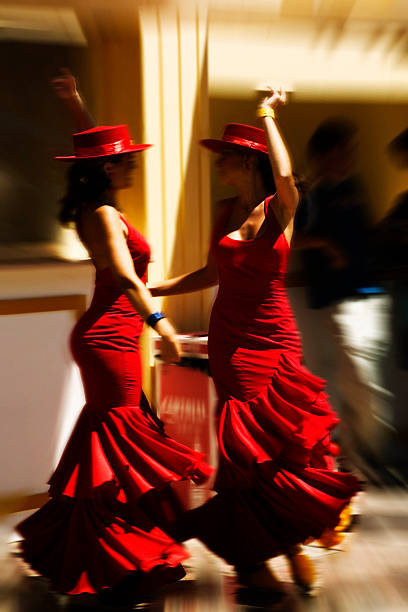 Flamenco Two Spanish girls dancing flamenco. Grain added. cordoba spain stock pictures, royalty-free photos & images