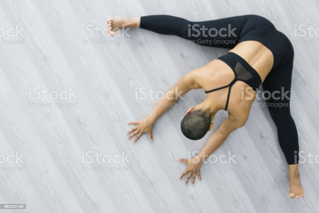 Aerial view of a strong flexible young woman of african descent...