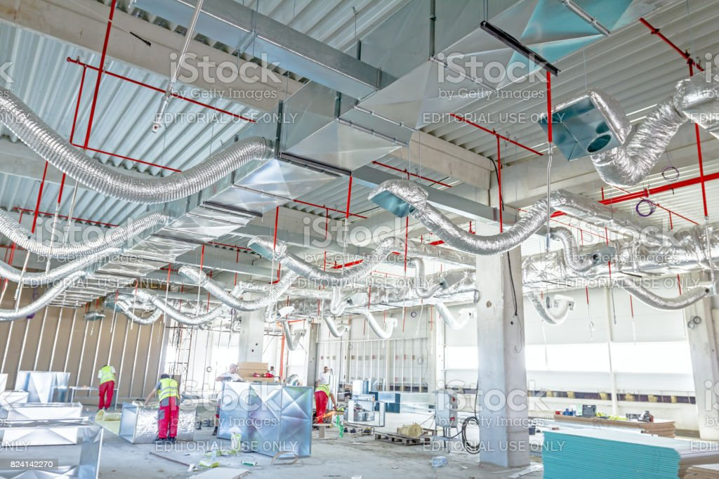 Flexible air conditioning and fire fighting system is placed on the ceiling stock photo