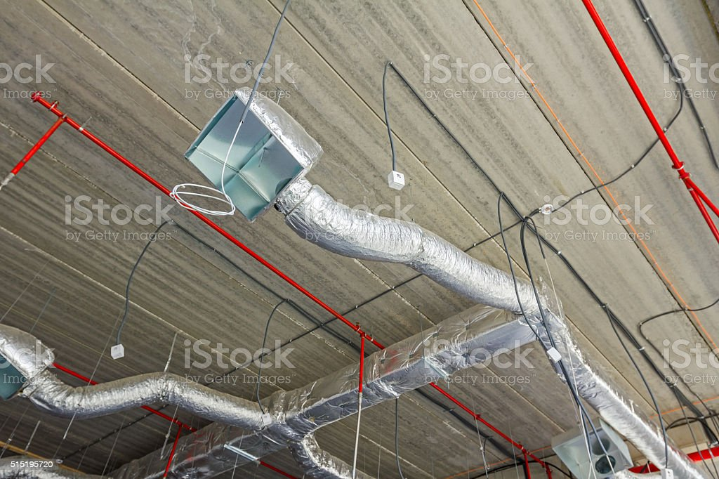 Flexible air conditioning and fire fighting system on the ceilin stock photo