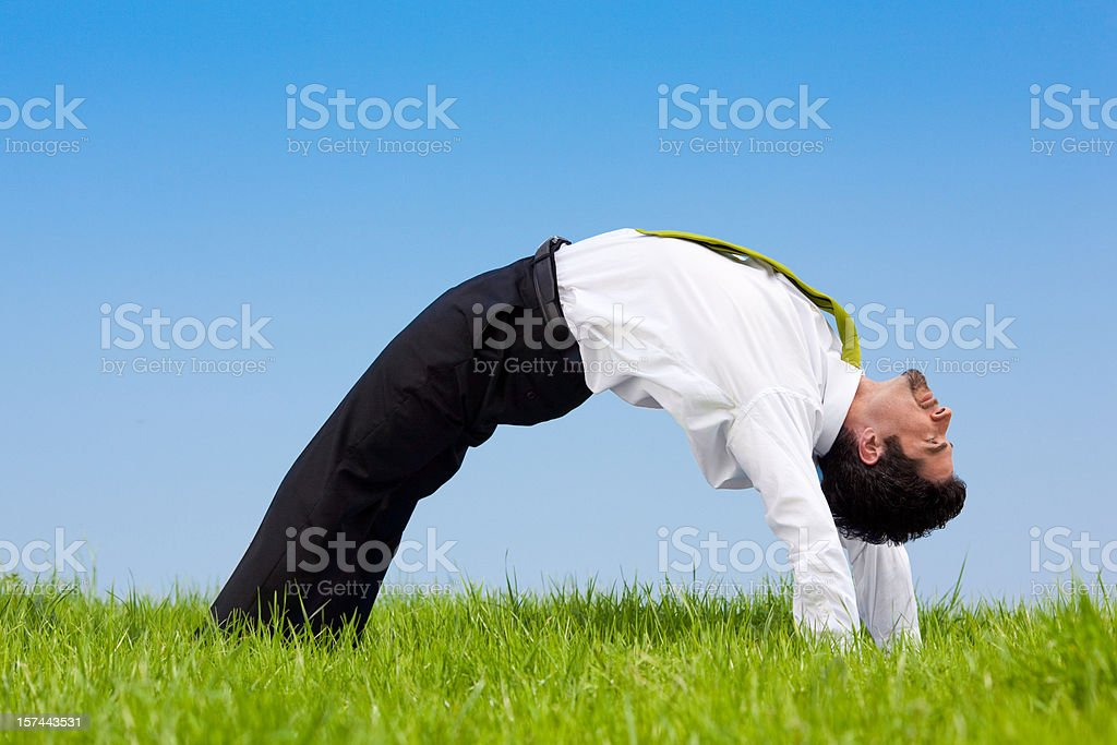 flexible business manager outdoor job bending over backwards royalty-free stock photo