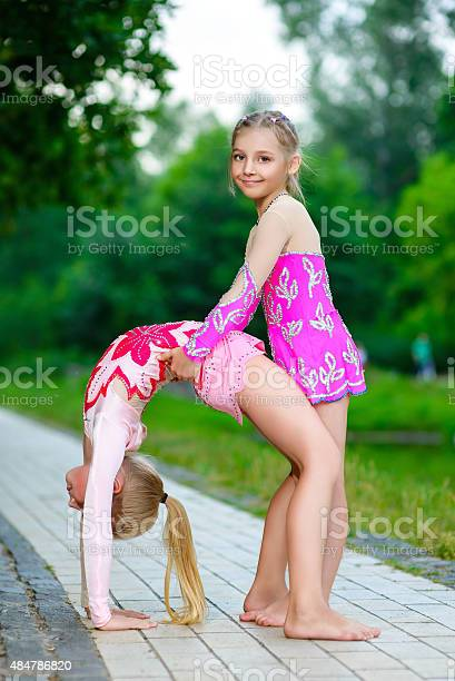 Flexible Little Girl Doing Gymnastics Split Stock Photo