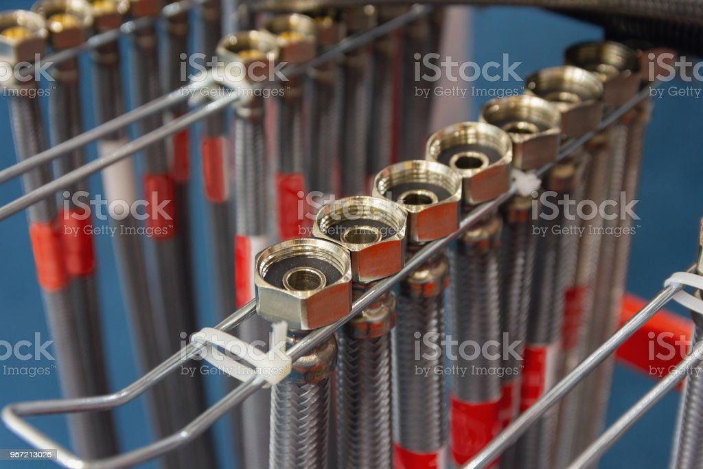 Flexible metal water hoses on the store counter. Plumbing