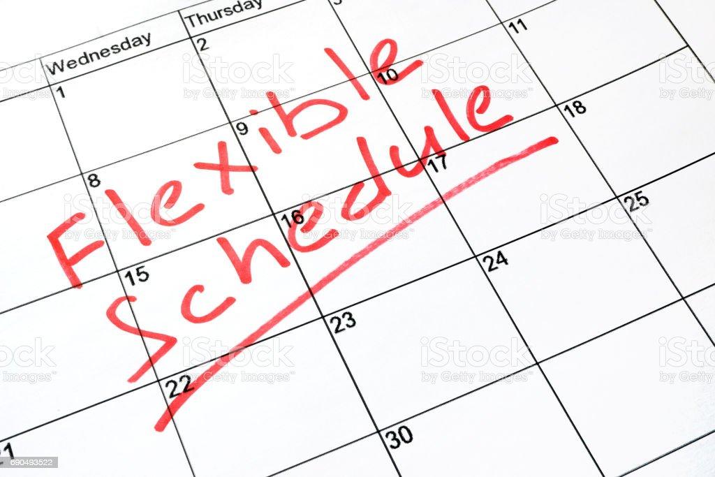 Flexible schedule written on a calendar. royalty-free stock photo
