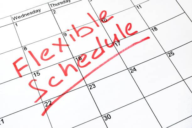 Flexible schedule written on a calendar. stock photo