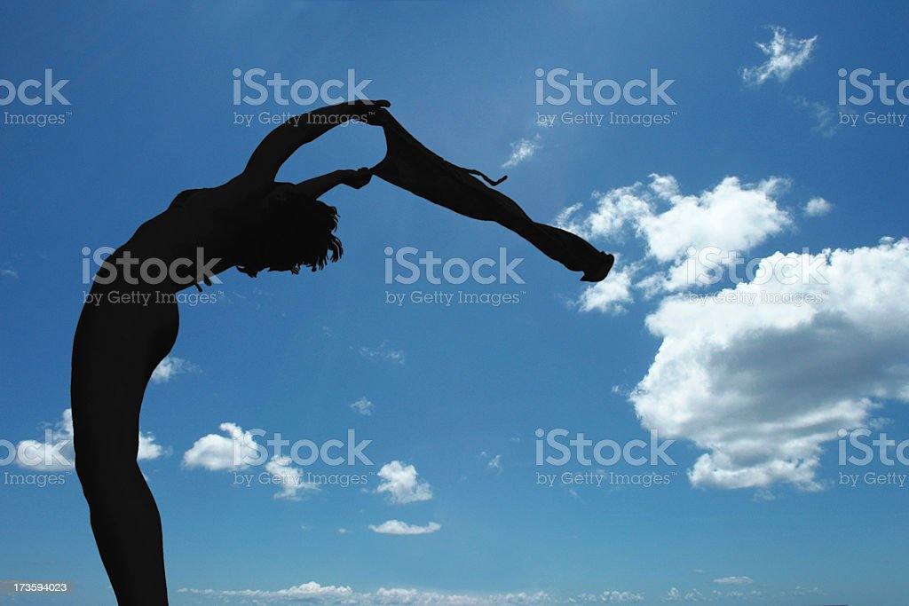 flexible silhouette on blue sky royalty-free stock photo