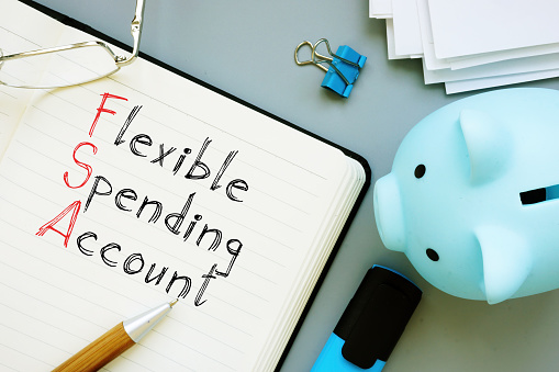 Flexible Spending Account FSA is shown on a conceptual business photo using the text