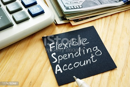 Flexible spending account FSA sign on a black piece of paper.