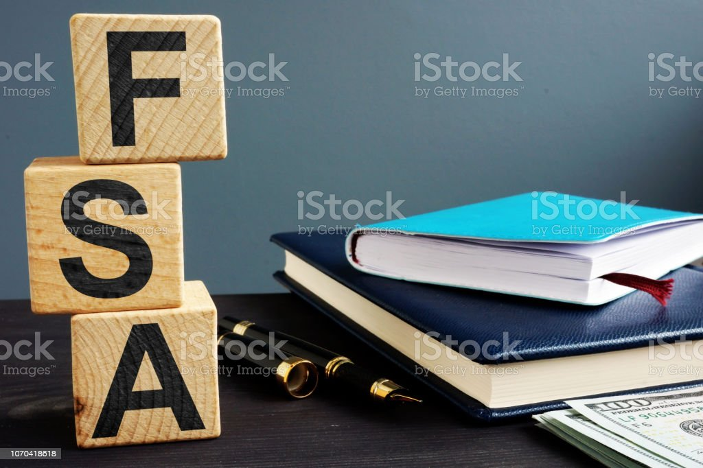 Flexible spending account FSA written on a wooden cubes. royalty-free stock photo