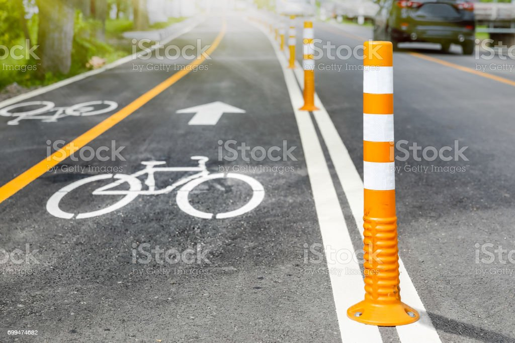 Flexible traffic bollard for bike lane. stock photo