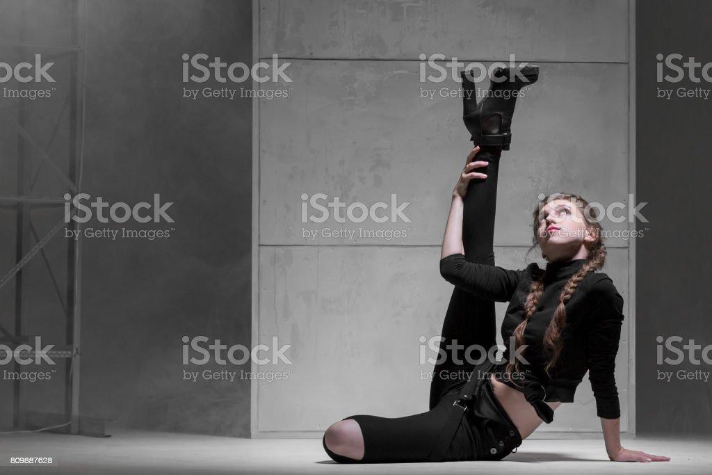 Flexible Woman Performing Modern Dance stock photo