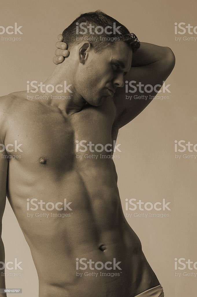 flexing ab muscles royalty-free stock photo