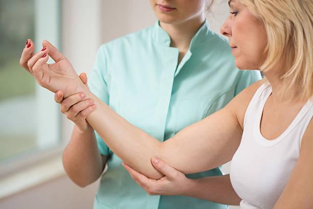 Flexing the elbow stock photo