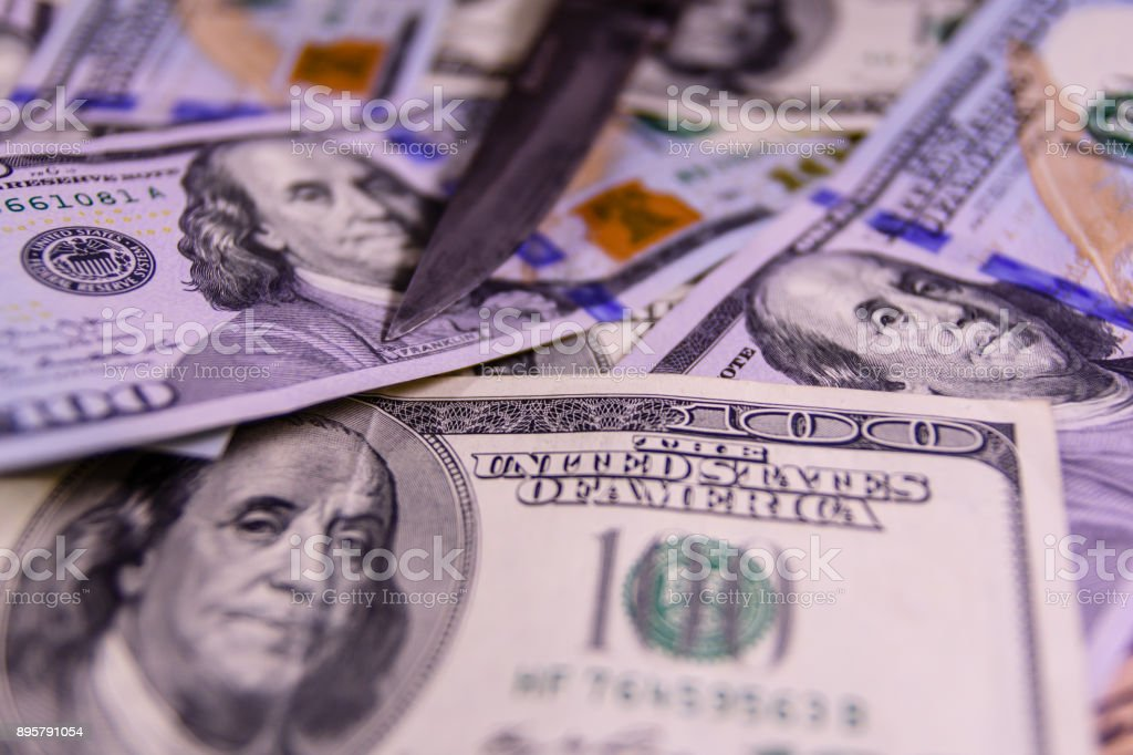 flick knife on a one hundred dollar bills stock photo more