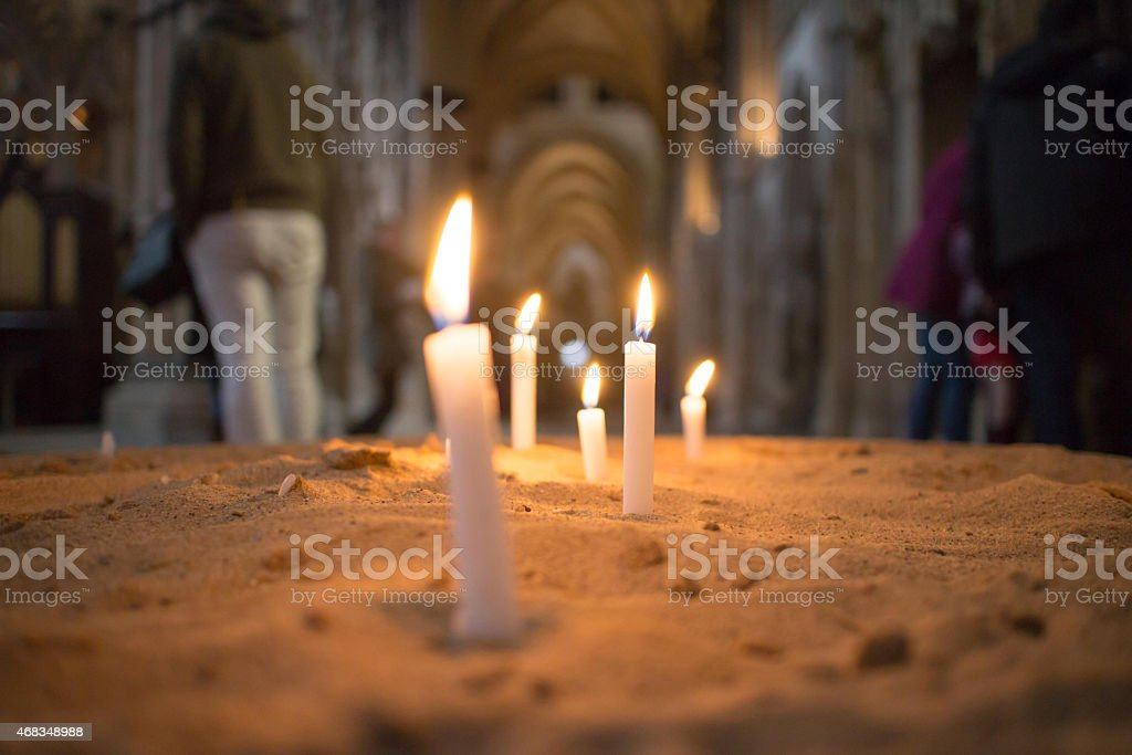 Flickering remembrance candles burning in a church royalty-free stock photo
