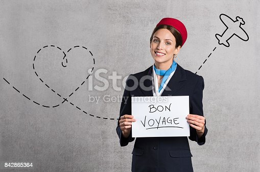 istock Flight assistant holding white sign 842865364